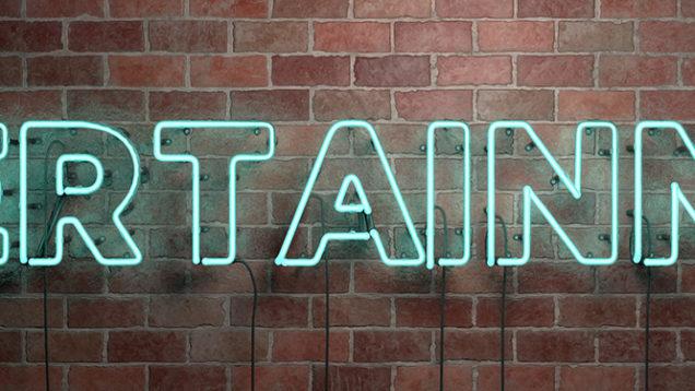 ENTERTAINMENT – fluorescent Neon tube Sign on brickwork